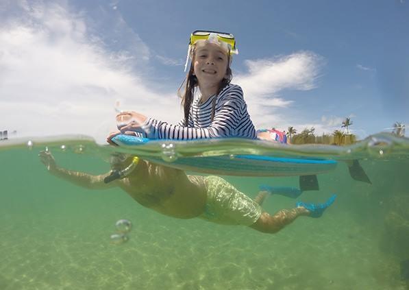 little girl snorkeling in kauai